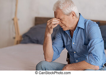Moody aged man feeling unhappy - Period of depression. Moody...