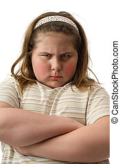 Closeup view of a moody child with her arms crossed, isolated against a white background