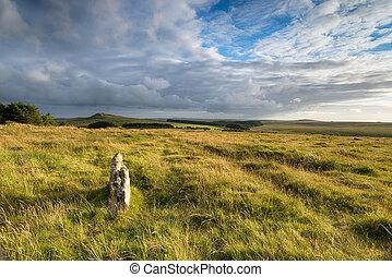 Moody Moorland - A moody sky over rugged grassy moorland on...
