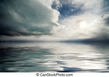 Moody sky - Atmospheric cloudy storm sky over rippling lake