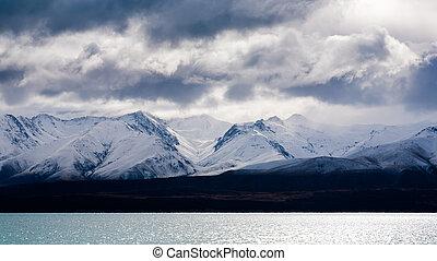 Moody sky over snow capped mountains Lake Pukaki South...