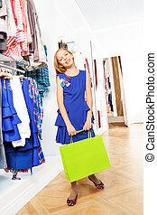 mooi, blauwe , meisje, jurkje, winkel, vrolijke