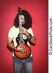 mooi, gitaar, elektrisch, krullend, jonge, langharige, vasthouden, kerel
