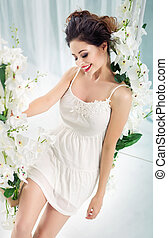 mooi, jonge vrouw , zittende , op, de, seesaw