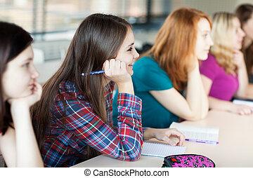 mooi, jonge, zittende , klaslokaal, vrouwelijke student, universiteit