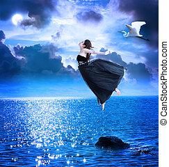 mooi, meisje, springt, in, de, blauwe , avond lucht