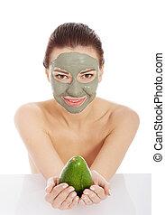 mooi, spa, vrouw, in, gezichtsmasker, en, avocado