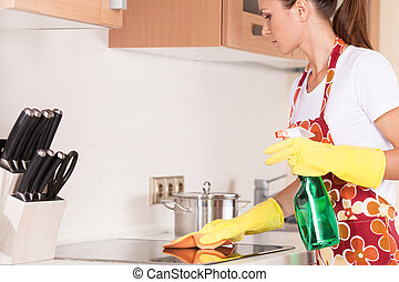 mooi, staand, brunette, apron, jonge, kitchen., wasmiddelen...