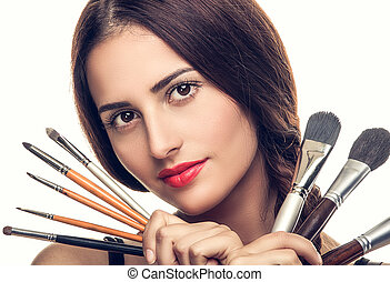 mooie vrouw, borstels, makeup