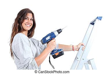 mooie vrouw, met, een, boor, op, een, ladder
