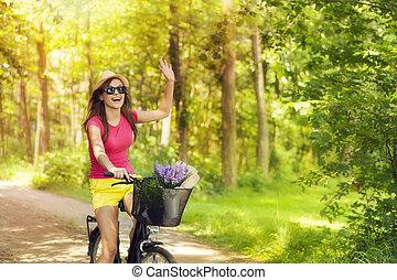 mooie vrouw, zwaaiende , om te, iemand, gedurende, cycling