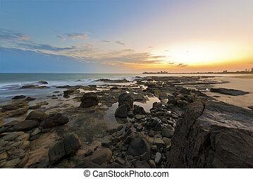 Mooloolaba Sunrise - Sunrise depicted from rocky beach of...