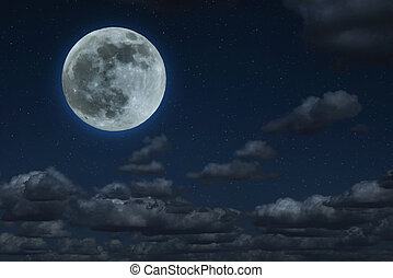 Moon and clouds in the night. Moonlight background.