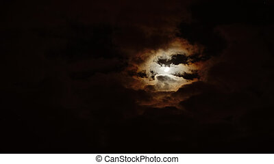 Moon and night sky with clouds.