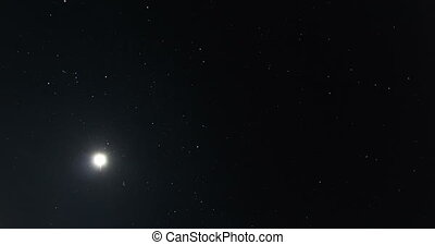 moon and stars fly in night sky