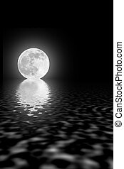 Abstract of a full moon on the spring equinox with reflection over rippled water against a black sky.