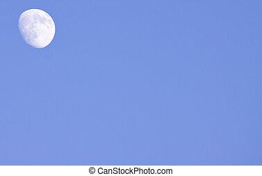 Moon by daylight - Moon in upper left corner by blue skies