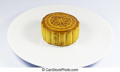 moon cake on white dish to eat