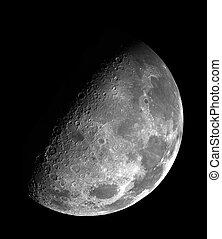 Large half moon on black night sky - close up
