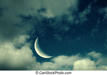 moon, clouds and stars night landscape