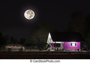 Moon cottage with a car in the middle of the night.