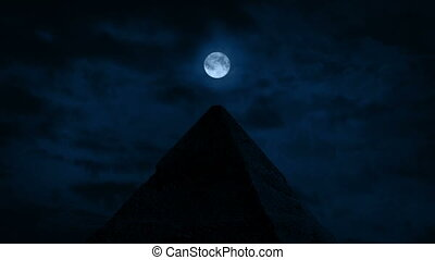 Moon Directly Over The Pyramid Top - Full moon above a...