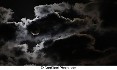 Moon disappearing in the clouds