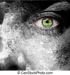 Moon image superimposed on a man's face with green eye