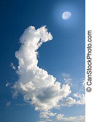 Moon in blue sky.