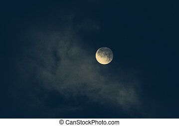 moon in night skies covered by the cloud. Monochrome