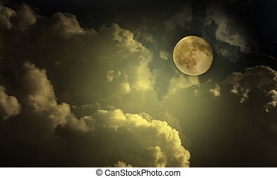 moon in the night sky clouds