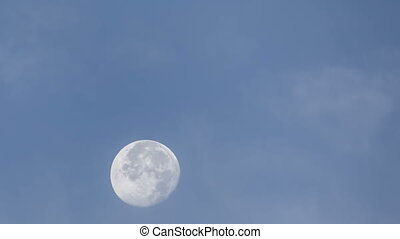 Moon in Twilight - Time lapse of the moon with clouds during...