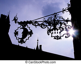 Moon Ironwork on the side of a building