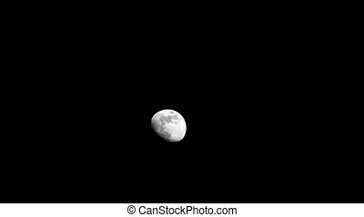 moon move on dark night sky and soft cloud passing