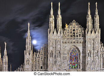 moon on cathedral steeples, Milan - Milan (Italy) cathedral...