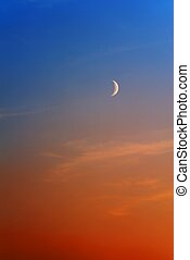 Moon on orange blue sky - Waxing Crescent Moon on sky...