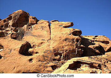 Moon over Desert rock formations