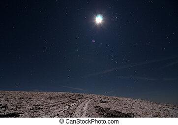 Moon over snowy path