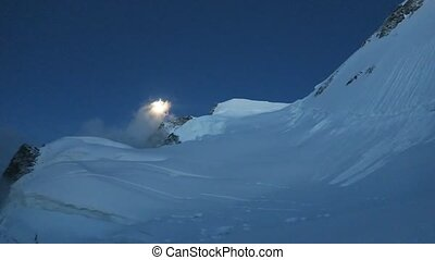 Moon over the Belukha Altai Mountains. Night landscape....