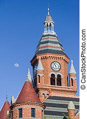 Moon over the clock tower of Old Red Museum in Dallas, Texas