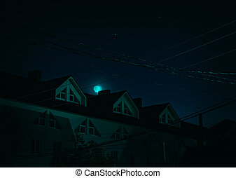 Moon over the house