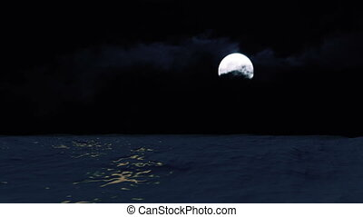 Moon over the ocean reflecting in the water