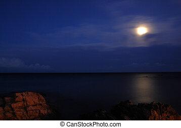 Moon over the sea - Moon is shining over the calm sea