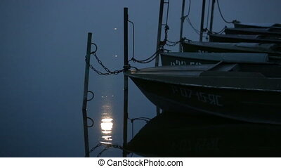 Moon reflection in sea and boats - Parked boats and moon...