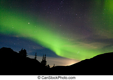 Moon rise hills northern lights Aurora borealis - Intense...