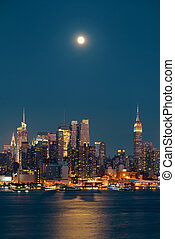 Moon Rise Manhattan - Moon rise over midtown Manhattan with...