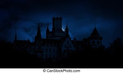 Moon Rises Behind Gothic Castle - Full moon moves behind...