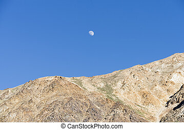 Moon rising over mountains
