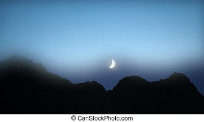 moon setting behind mountains, Turkey