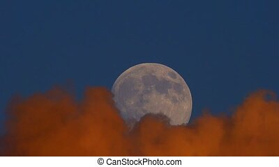 moon against the background of clouds at a sunset